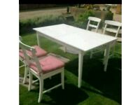 White Ikea extendable dinning table and 6 chairs.