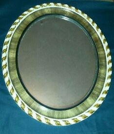 Vintage oval mirror scalloped edges leaf design brown and cream colour original chain wooden back