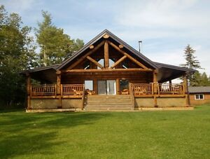 Executive waterfront log home for sale