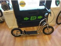 Silver off road scooter with handle bar brakes, good tyres kids ideal for half term childrens