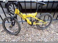 Boys bike . Raleigh bike . Mountain bike . Bike . 24 inch wheel size yellow