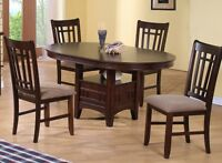 Brand new 5 piece dining set with center leaf..taxes in.