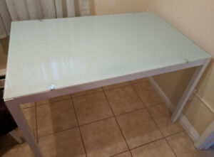 Beautiful glass top dining room table  for sale.