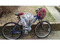 Mountain bike with helmet, bike lock and chain, and tarp
