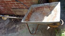 vintage rustic wheelbarrow for sale for use or garden decoration