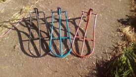 Three metal Saddle Racks.