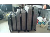 SUITCASES REVELATION X THREE, GREY HARD SHELL, FOUR SWIVEL WHEELS BRAND NEW