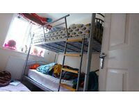 almost new single bunk bed (metal frame)