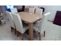 Dining table and six chairs in excellent condition table is extending