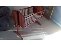 Swinging crib with washable mattress in excellent condition