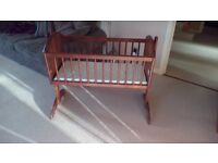 Swinging baby crib with washable mattress
