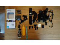 2014 Go Pro Hero in box with mounts, charging cable and 32GB SD card