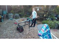 Folding heavy duty trolley used for transporting fishing gear, folds up for storage.