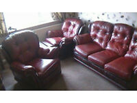 Oxblood red chesterfield sofa and 2 chairs