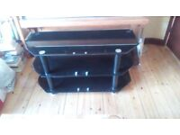 Black glass television stand with 2 bottom shelves