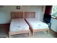 2 solid wood single beds with matresses, £150 must collect.