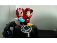 Mickey and minnie mouse animated telephone.