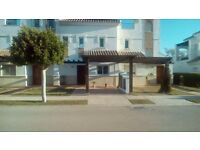 A LOVELY 2 BEDROOM 2 BATHROOM RENTAL OVERLOOKING GARDENS AND A 35 METRE POOL IN SUNNY MURCIA SPAIN.