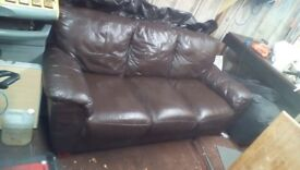 Dark brown leather sofa and chair . Good condition