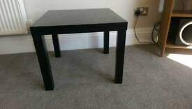 2 coffee tables, one white, one black.