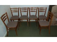 6 wood framed dining chairs with brown/beige seat covers
