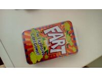 The FART GAME CARDS IN A TIN, new sealed in a tin