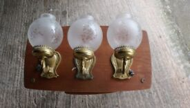 Three Brass wall lights with glass shades