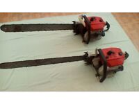 Pair of Stihl vintage 32 inch blade chainsaws