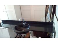 Marble sink and quality taps. In excellent condition.