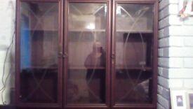 Glass display unit with cupboard storage