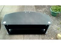 Large television unit in black glass