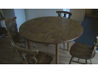 Dining Table and 4 chairs round and drop leaf
