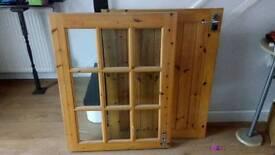 Wooden door glass split in two