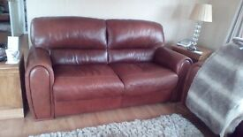 Two 3 Seater leather sofas and 1 leather footstool
