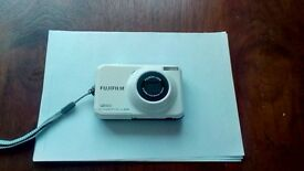 Fuji white l55 digital camera.with memory card .and charger