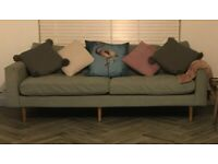 Light green four seater sofa