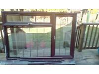 Rosewood coloured upvc double glazed window.