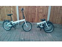 2 Folding Carrera Transit Bicycles.
