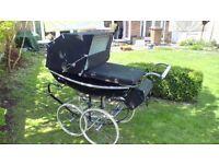 Silver Cross Black Coach Pram with large shiny wheels