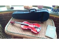 Beautiful half size childs violin and case.