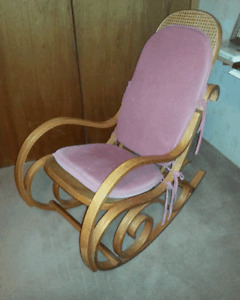 Bentwood rocker with cushion.