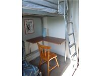 Metal High Bed Frame and Attached Desk in Good Conditions, already dismantled. Can deliver