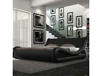 Leather framed double bed.
