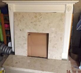 Marble fireplace and hearth with wooden surround