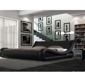 King size black leather bed