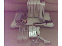 Nintendo Wii + 9 games inc mario allstars + balance board