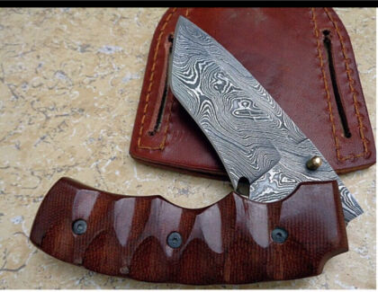 Handmade Damascus steel folding knife