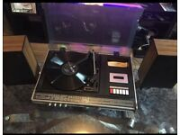 Vintage record player with cassette player and radio