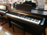 Roland HP-102e Digital Piano Full Size 88 weighte keys, 3 pedals, Rosewood colour.