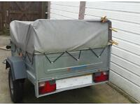 Trailer with camping equipment